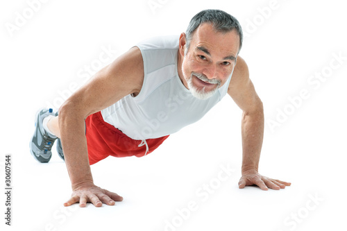 senior man doing push-ups exercise in gym