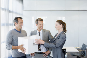 Business people stacking cubes in conference room