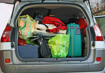 car trunk filled with luggage ready to leave for the holidays