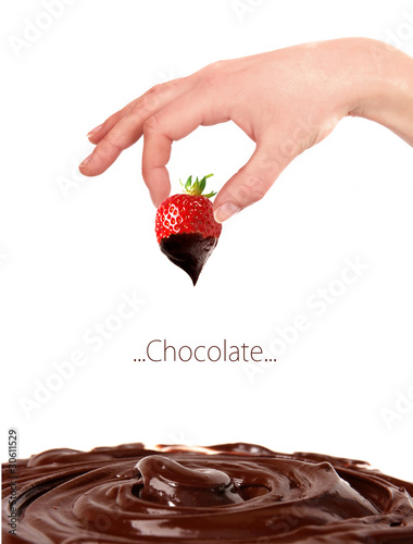Strawberry dipped in melting chocolate