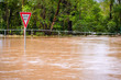 Leinwanddruck Bild - Very flooded road and give way sign, Queensland, Australia