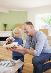 Father showing son model car in new house