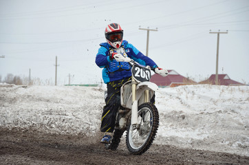 Russia, Samara March 6,2011, motocross rider accelerated