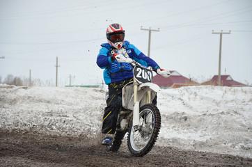 Russia, Samara March 6,2011, motocross rider accelerated