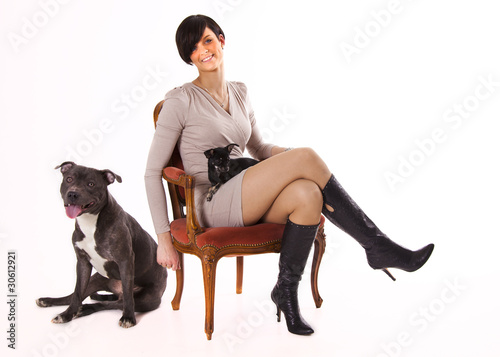 Woman with her dogs chihuahua and English Stafford