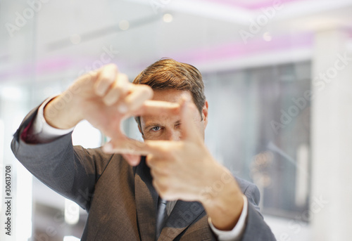 Businessman making framing gesture with hands