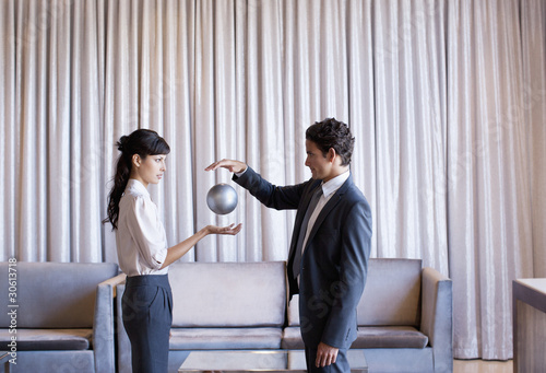 Business people high-fiving in hotel lobby