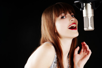 young artist woman recording in a studio
