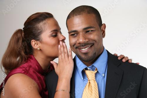 Woman whispering in husband's ear
