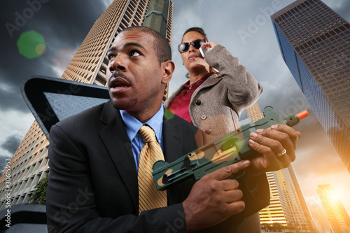 Business war game, businesspeople with gun in city.