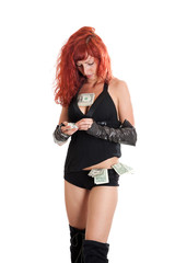 sexy young red-haired woman with money