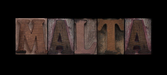 the word Malta in old letterpress wood type