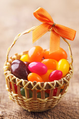 Colorful easter egg candy in basket