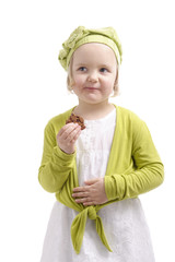 cute little girl eating a cookie
