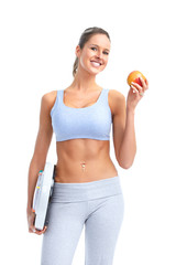 Fitness woman with apple