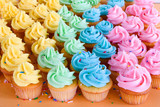 lots of rainbow cupcakes