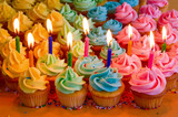 rainbow cupcakes with birthday candles
