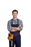 Carpenter standing on white background with arms crossed