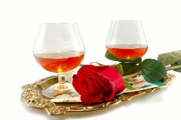 roses and glasses of cognac