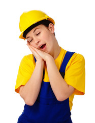 Young woman in construction uniform is yawning
