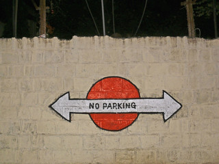 Signboard of no parking in this area , India