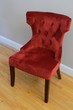 Plush Red Chair on Hardwood Floor
