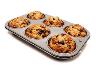 A tray of freshly baked muffins on white