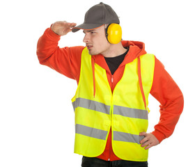 manual worker in protective waistcoat looking for something