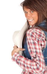 smiling country girl in chequered shirt with cowboy hat