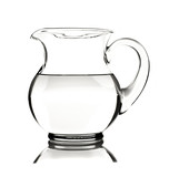 Glass water pitcher with water on white background
