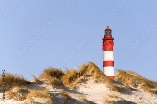 Leinwandbild Motiv Leuchtturm am Strand von Amrum
