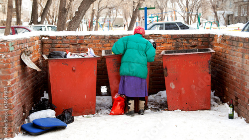 Woman looking in a trash food