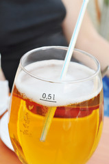 Beer in clear glass with bubbles, alcohol