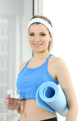 sportve fitness beautiful woman with a glass of water.