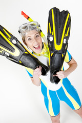 portrait of woman wearing neoprene with flippers and diving gogg