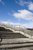 Stairs with metal handrails poster