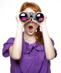 Teen red-haired girl with binoculars isolated on white backgroun