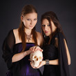 Two young girls with a human skull