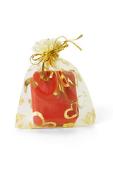 Red jewellery box in gold sachet