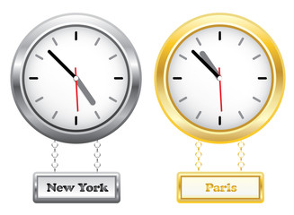 Silver and golden clocks showing time in New York and Paris