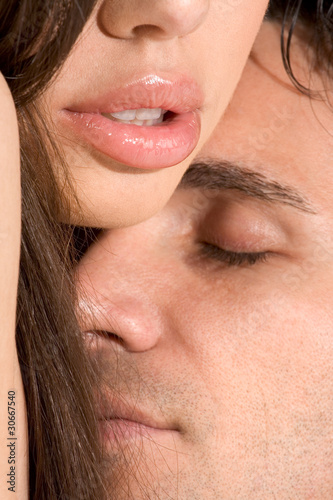 Young sensual Man and woman in love kissing