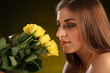 Portrait of beautiful woman with yellow roses