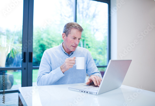 Man using laptop at table