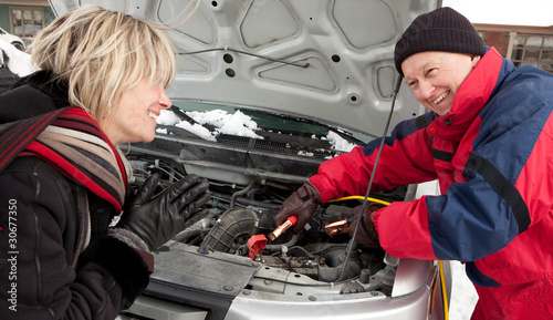 Woman getting a boost for her car