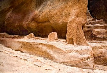 Remains of ancient statues in the Siq in Petra, Jordan