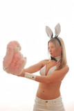 Bunny Girl looking at cuddly toy poster