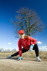 Woman stretches after cross country running