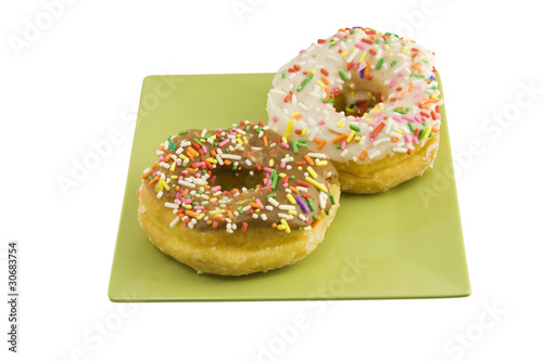 two sprinkled doughnuts