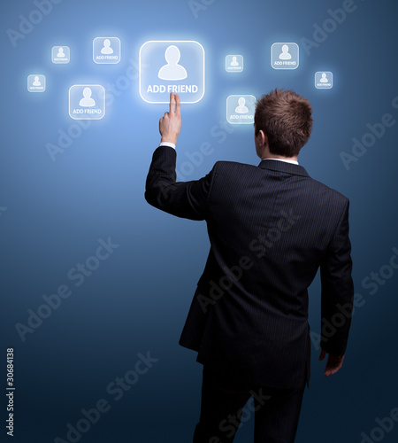 man  hand pressing Social network icon
