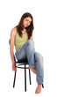 Girl in green stripy top sit on stool.